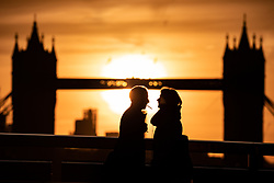October 8, 2018 - London, UK - The sun rises through Tower Bridge in London, on a cold morning. The capital is forecast unseasonably warm weather by the middle of the week, with temperatures reaching up to 23 degrees Celsius. (Credit Image: © Tom Nicholson/London News Pictures via ZUMA Wire)