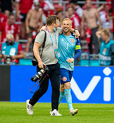 AMSTERDAM, THE NETHERLANDS - Saturday, June 26, 2021: Denmark's goalkeeper Kasper Schmeichel celebrates with the team photographer after the UEFA Euro 2020 Round of 16 match between Wales and Denmark at the Amsterdam Arena. Denmark won 4-0. (Photo by David Rawcliffe/Propaganda)
