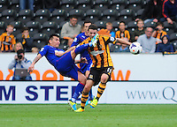 Hull City's Robbie Brady gets caught in the face by the boot of Cardiff City's Gary Medel <br /> <br /> Photo by Chris Vaughan/CameraSport<br /> <br /> Football - Barclays Premiership - Hull City v Cardiff City - Saturday 14th September 2013 - Kingston Communications Stadium - Hull<br /> <br /> © CameraSport - 43 Linden Ave. Countesthorpe. Leicester. England. LE8 5PG - Tel: +44 (0) 116 277 4147 - admin@camerasport.com - www.camerasport.com