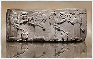 Picture & image of a Neo-Hittite orthostat with a releif sculpture a libation for the gods from Aslantepe ,  Malatya, Turkey. Museum of Anatolian Civilisations, Ankara. The figure on the far left is beleived to be a king. He is facing a Bearded God wearing a bore tusk helmet. The God is holding a 3 pronged object and has a club resting on his shoulder. The 2 shaven characters on the right are mirror images of the two figures on the right except this time the king is on the far right waering a winged sun disc headress and holding a Lituus. The epigraphs identify the king and the cresent on the beared gods helmet identify him as Pugnus Mili The Sum and Moon God. 2 <br /> <br /> If you prefer to buy from our ALAMY STOCK LIBRARY page at https://www.alamy.com/portfolio/paul-williams-funkystock/hittite-art-antiquities.html . Type - Aslantepe - in LOWER SEARCH WITHIN GALLERY box. Refine search by adding background colour, place, museum etc.<br /> <br /> Visit our HITTITE PHOTO COLLECTIONS for more photos to download or buy as wall art prints https://funkystock.photoshelter.com/gallery-collection/The-Hittites-Art-Artefacts-Antiquities-Historic-Sites-Pictures-Images-of/C0000NUBSMhSc3Oo