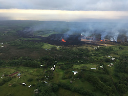 Handout photo taken on May 18, 2018 of KÄ«lauea Volcano — Spattering. Fissure 17 (middle photo) and fissure 18 (left side photo) during this morning's overflight of the area. View is toward the south. Photo by usgs via ABACAPRESS.COM