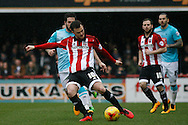 Josh McEachran of Brentford preparing to cross during the Skybet football league championship match, Brentford  v Derby county at Griffin Park in London on Saturday 20th February 2016.<br /> pic by Steffan Bowen, Andrew Orchard sports photography.