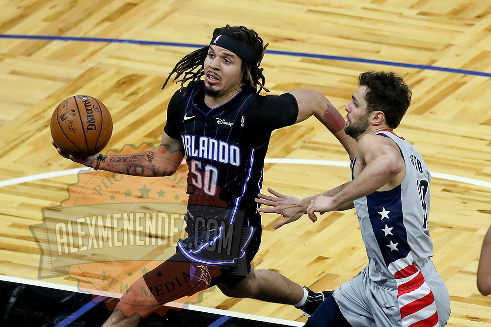 ORLANDO, FL - APRIL 07: Cole Anthony #50 of the Orlando Magic controls the ball against Raul Neto #19 of the Washington Wizards at Amway Center on April 7, 2021 in Orlando, Florida. NOTE TO USER: User expressly acknowledges and agrees that, by downloading and or using this photograph, User is consenting to the terms and conditions of the Getty Images License Agreement. (Photo by Alex Menendez/Getty Images)*** Local Caption *** Cole Anthony; Raul Neto