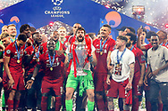 CHAMPIONS Liverpool players celebrate as Liverpool goalkeeper Alisson Becker (13) lifts the trophy after the UEFA Champions League Final match between Tottenham Hotspur and Liverpool at Wanda Metropolitano Stadium, Madrid, Spain on 1 June 2019.