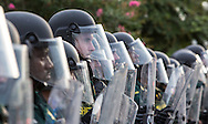 Police in riot gear in Baton Rouge on Sunday July 7.  Almost a week after fatal police shooting of Alton Sterling last week, At least 48 people had been were taken into custody by midnight Sunday,