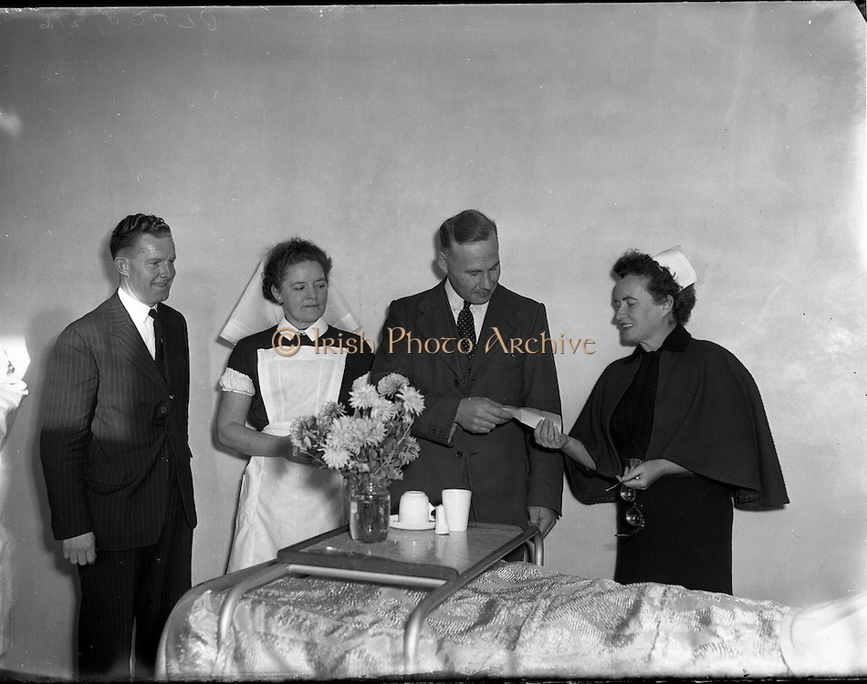 04/11/1955<br /> 11/04/1955<br /> 04 November 1955<br /> Cerebos special presentation for Bisto competition winner at Monaghan for McConnell's. Nurse being presented with cheque.