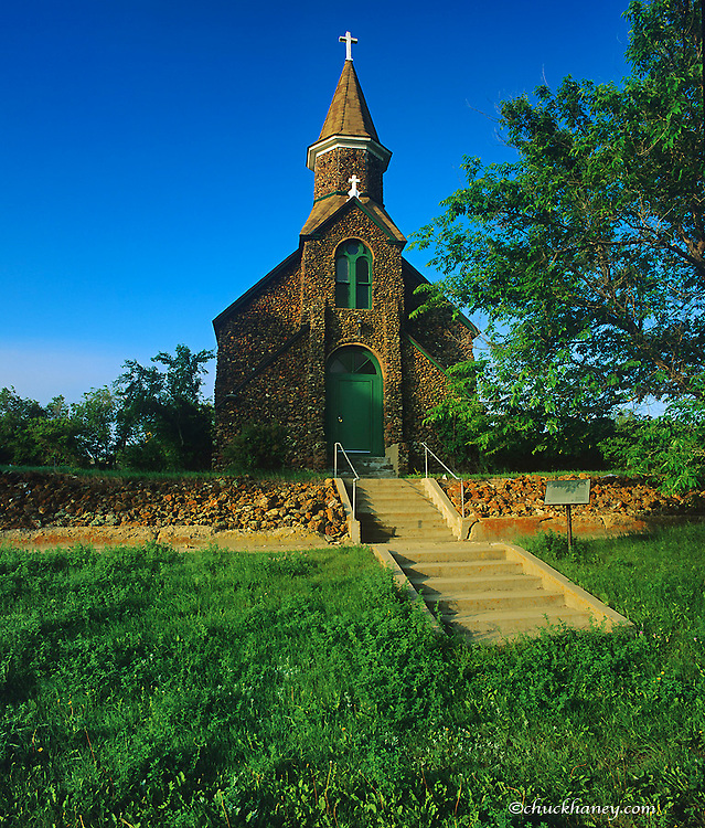 Historic St Peters Catholic Church built in 1895 with lava rock in Wibaux, Montana, USA