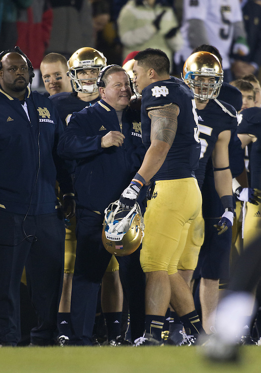 November 17, 2012:  Notre Dame inside linebacker Manti Te'o (5) and head coach Brian Kelly celebrate during NCAA Football game action between the Notre Dame Fighting Irish and the Wake Forest Demon Deacons at Notre Dame Stadium in South Bend, Indiana.  Notre Dame defeated Wake Forest 38-0.