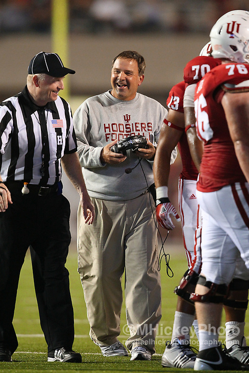 Sept. 10, 2011; Bloomington, IN, USA; Indiana Hoosiers head coach Kevin Wilson talks with a referee against the Virginia Cavaliers at Memorial Stadium. Virginia defeated Indiana 34-31.  Mandatory credit: Michael Hickey-US PRESSWIRE
