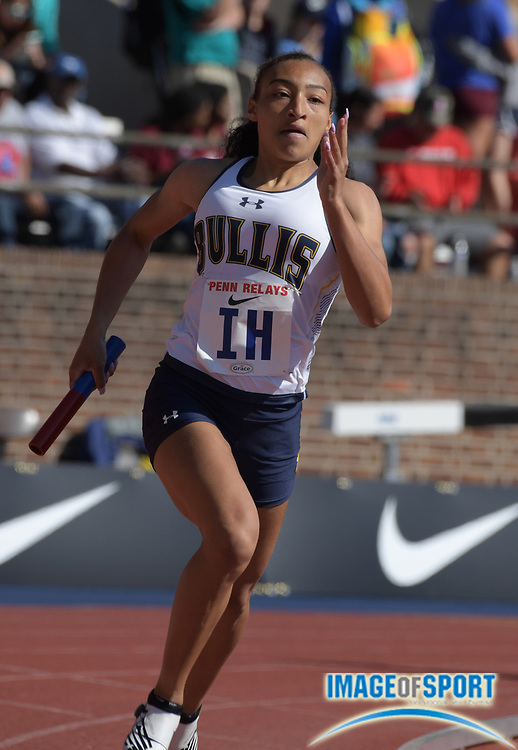 Apr 26, 2018; Philadelphia, PA, USA; Lauryn Harrisruns the third leg on the Bullis (Md.) girls 4 x 400m relay that won its heat in 3:42.42 during the 124th Penn Relays at Franklin Field.