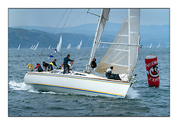 Historic Scottish Series Images<br /> <br /> Barracuda sailed by Bob fisher and star of 1980's Tv Series Howard's Way sails around the McEwan's Branded Weather Mark.<br /> <br /> Picture Copyright  PFM Pictures