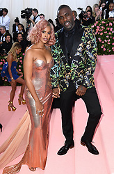 "Idris Elba and Sabrina Dhowre at the 2019 Costume Institute Benefit Gala celebrating the opening of ""Camp: Notes on Fashion"".<br />