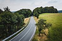 Aerial view of winding road trough forrest in National Park Sächsische Schweiz, Germany.