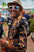 Glastonbury Festival, 2015.<br /> Man smiling, wearing sparkly jacket