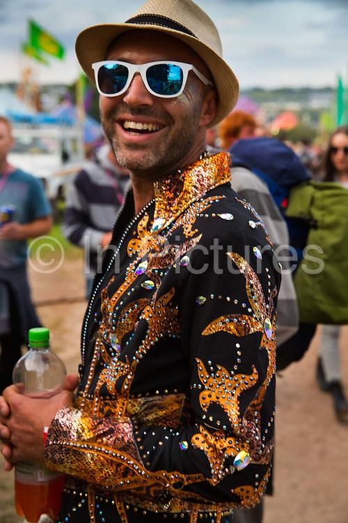 Glastonbury Festival, 2015.<br /> Man smiling, wearing sparkly jacket