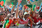 Portuguese supporters celebrating with national flags and  awaiting for the football team to arrive at Alameda Dom Afonso Henriques, in Lisbon. Portugal's national squad won the Euro Cup the day before, beating in the final France, the organizing country of the European Football Championship, in a match that ended 1-0 after extra-time.