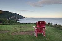 Red adirondack chair at viewpoint, Cape Breton Highlands National Park, Cape Breton Island Nova Scotia