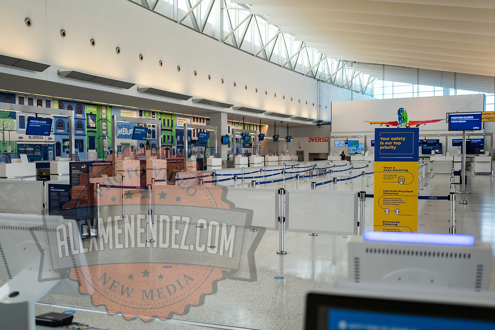 The JetBlue ticket counter at JFK Airport remains sparse during the Phase 4 reopening on Wednesday August 5, 2020 in New York, New York. Mayor de Blasio is asking travelers from 34 states and Puerto Rico, where COVID-19 infection rates are high, to quarantine for 14 days after arriving in the city.  (Alex Menendez via AP)