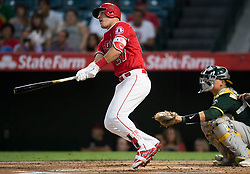 August 30, 2017 - Anaheim, CA, USA - The Los Angeles Angels Mike Trout hits a solo home run in front of catcher Bruce Maxwell in the first inning against the Oakland Athletics at Angel Stadium in Anaheim, CA on Wednesday, August 30, 2017. (Photo by Kevin Sullivan, Orange County Register/SCNG) (Credit Image: © Kevin Sullivan/The Orange County Register via ZUMA Wire)