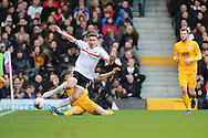 Preston North End defender Tom Clarke (5) tackling Fulham midfielder Tom Cairney (10) during the EFL Sky Bet Championship match between Fulham and Preston North End at Craven Cottage, London, England on 4 March 2017. Photo by Matthew Redman.