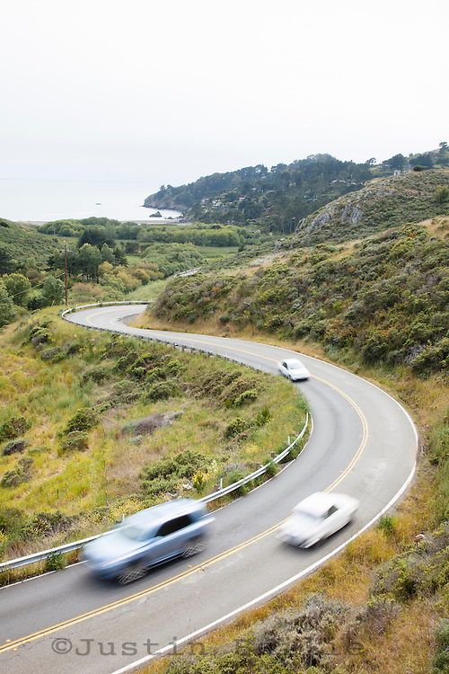 Cars driving road into Muir Beach in Golden Gate National Recreation Area. Marin Headlands. San Francisco, CA.