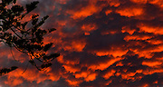 06 October 2011-Santa Barbara, CA: I was at a USA gas station on Milpas St. (SB) lamenting the fact I was pumping more gas in my car.  Then, I glanced up and saw what the sunset winds blew in.  Quick pickup my camera!  Photo by Rod Rolle