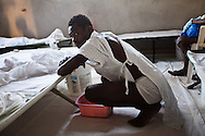 Pauleis Senti  gets out of bed in case he will need to vomit again at a cholera clinic.The Real Hope for Haiti  Cholera Clinic in Cazel is 11 kilometers off the main road passing through Cabaret, north of Port-au-Prince is run by missionaries.
