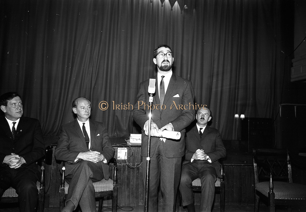 """24/07/1967<br /> 07/24/1967<br /> 24 July 1967<br /> First showing of """"Fleá Cheoil"""" at the Metropole Cinema, Dublin. A presentation was made to the director of the film Mr. Louis Marcus, for winning the Silver Bear Award at the Berlin International Film Festival, by Taoiseach Jack Lynch TD, on behalf of the Cork Film Society, where Mr. Marcus began his carrier. President of the Society Mr. Sean Hendrick attended the presentation. Picture shows Louis Marcus, Director of the film, addressing the attendees at the presention. Alo on the platform are from left Mr. Padraig Faulkner, Parliamentary Secretary to the Minister for the Gaeltacht; Taoiseach Mr. Jack Lynch and Donal O Móráin, Ceannasai Gael-Linn."""