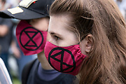 Extinction Rebellion activists with face masks at the Marine Rebellion march on 6th September 2020 in London, United Kingdom. Ocean Rebellion, Sea Life Extinction, Animal Rebellion and Extinction Rebellion joined together to celebrate the biodiversity found in our seas, and to grieve at the destruction of the Earth's oceans and marine life due to climate breakdown and human interference, and the loss of lives, homes and livelihoods from rising sea levels. Extinction Rebellion is a climate change group started in 2018 and has gained a huge following of people committed to peaceful protests. These protests are highlighting that the government is not doing enough to avoid catastrophic climate change and to demand the government take radical action to save the planet.