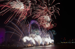 © Licensed to London News Pictures. 01/01/2018. London, UK. A spectacular fireworks display lights up the London skyline just after midnight on January 1, 2018 in central London as part of the capitals New Year's Eve celebrations. Thousands of people lined the banks of the River Thames in London to see in the New Year. Photo credit: Ray Tang/LNP