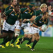 Fourie Du Preez, South Africa, with the ball with team mates Jannie Du Plessis, (back), Tendai Mtawarira, (left) Victor Matfield, (centre) and Schalk Burger, (back, right) during the Wales V South Africa, Pool D match during the Rugby World Cup in Wellington, New Zealand,. 11th September 2011. Photo Tim Clayton