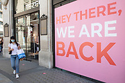 Shop announces that We are back as the Coronavirus lockdown measures are set to ease further, the west end starts to fill with people as they return to the shopping district on Oxford Street and the quiet city starts coming to an end on 22nd June 2020 in London, England, United Kingdom. As of today the government has relaxed its lockdown rules, and is allowing some non-essential shops to open with individual shops setting up social distancing queueing systems.