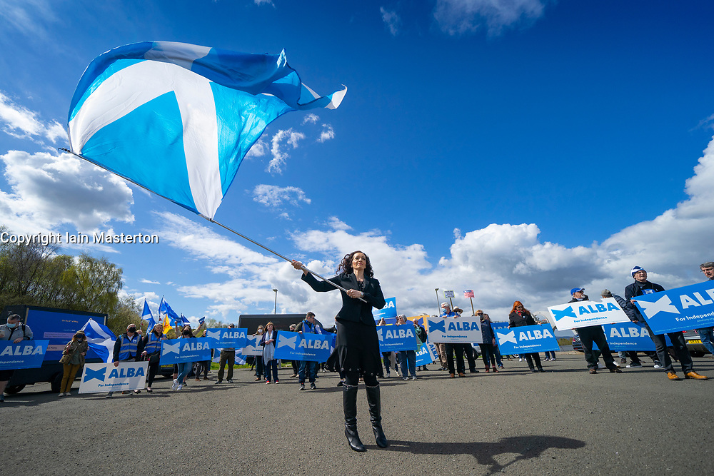 Falkirk, Scotland, UK. 30 April 2021. Leader of the pro Scottish nationalist Alba Party , Alex Salmond, campaigns with party supporters at the Falkirk Wheel ahead of Scottish elections on May 6th. Pic; List candidate Tasmina Ahmed-Sheikh holds large Saltire flag. Iain Masterton/Alamy Live News