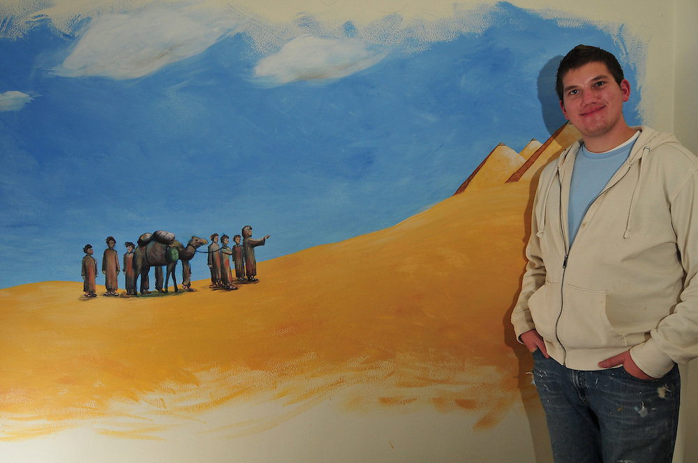 Timothy Gorichanaz, a sophomore at Marquette University, with the one of four murals he painted in the chapel at O'Donnell Hall, Thursday Oct. 23 2008.