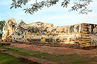 Wat Lokayasutharam where the largest reclining Buddha is to be found in Ayutthaya.  It is 32 meters long and 8 meters high.  There is no vihara to shelter the image. In the past the vihara roof was made of tin and was struck by lightning twice so it has been left outdoors ever since.