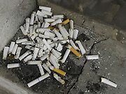 cigarette butts in a corner of a window sill