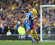 Chris O'Grady and Gabriele Angella during the Sky Bet Championship match between Brighton and Hove Albion and Watford at the American Express Community Stadium, Brighton and Hove, England on 25 April 2015.