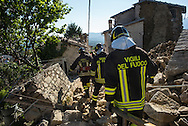 Firefighters climbing on some debries in Casale few kilometers form Amatrice. A 6,4 earthquake has hit central Italy during the night between the 23 and 24 August killing more than 100. The town of Amatrice is been heavily damaged.