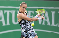 NOTTINGHAM, ENGLAND - JUNE 13: Magdalena Rybarikova of Slovakia hits a backhand against Mona Barthel of Germany during Day Five of the Nature Valley Open at Nottingham Tennis Centre on June 13, 2018 in Nottingham, United Kingdom.