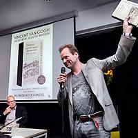 Nederland, Amsterdam , 3 oktober 2014.<br /> Eerste exemplaar brievenboek Vincent Van Gogh tijdens de persconferentie in het van Gogh museum<br /> Op de foto: schrijver Frank Westerman met het boek De kunst van het woord in de hand .<br /> Het boek is een verzameling van brieven , correspondentie van kunstschilder Vincent van gogh <br /> Links in beeld 1 van de samenstellers van het boek Leo Jansen.<br /> Foto:Jean-Pierre Jans