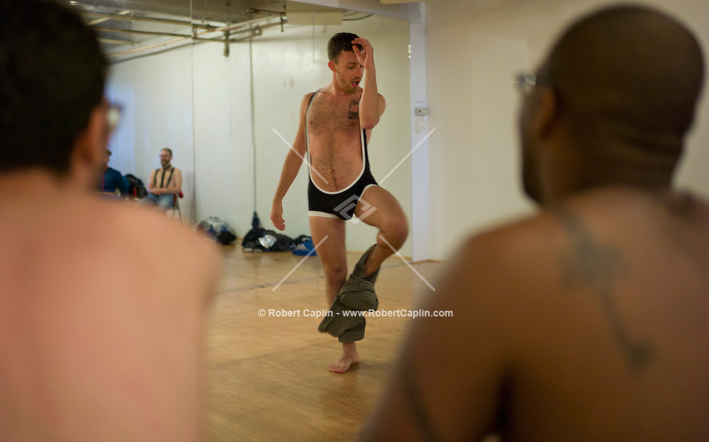 """<Redacted> works on a striptease during a """"Boylesque"""" Class, Burlesque dancing for men, at Triskelion Arts Center in Williamsburg, Brooklyn...Photo © Robert Caplin.."""