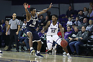 HIGH POINT, NC - JANUARY 06: High Point's Andre Fox (22) is guarded by Charleston Southern's Jordan Jones (13). The High Point University of Panthers hosted the Charleston Southern University Buccaneers on January 6, 2018 at Millis Athletic Convocation Center in High Point, NC in a Division I men's college basketball game. HPU won the game 80-59.