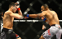 October 29, 2017 - Brazil - SAO PAULO, SP - 29.10.2017: UFC FIGHT NIGHT - Fight between Pedro Munhoz (black)? Robber-weight UFC vs. Rob Font (gray)? UFC Fight Cock, during the UFC Fight Night held on Saturday (28) with the main fight between Brunson vs. Machida, at the Gymnasium of Ibirapuera, south of the city of Sao Paulo. Victory of Brazilian Munhoz. (Credit Image: © Fotoarena via ZUMA Press)