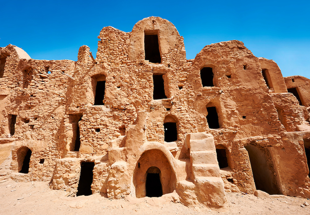 The traditional north Sahara fortified Berber Ksar El Mguebl and its adobe mud ghorfas graneries, near Tataouine, Tunisia<br /> <br /> Visit our TUNISIA HISTORIC PLACES PHOTO COLLECTIONS for more photos to browse or download or buy as prints https://funkystock.photoshelter.com/gallery-collection/Pictures-Images-Photos-of-Tunisia/C0000lMpN5pUP1CM <br /> .<br /> Visit our ISLAMIC HISTORICAL PLACES PHOTO COLLECTIONS for more photos to download or buy as wall art prints https://funkystock.photoshelter.com/gallery-collection/Islam-Islamic-Historic-Places-Architecture-Pictures-Images-of/C0000n7SGOHt9XWI
