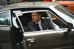 A stunt double inside an Aston Martin as filming for the upcoming Bond film takes place on the Mall in London. The as-yet-untitled project has been shooting in Jamaica and at Pinewood Studios but the official 007 Twitter account confirmed the spy movie is now filming in the capital.