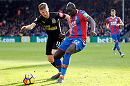 Mamadou Sakho of Crystal Palace (R) in action with Matt Richie of Newcastle Utd (l). Premier League match, Crystal Palace v Newcastle Uutd at Selhurst Park in London on Sunday 4th February 2018. pic by Steffan Bowen, Andrew Orchard sports photography.