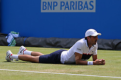 France's Julien Benneteau slips over on the grass during day two of the 2017 AEGON Championships at The Queen's Club, London.