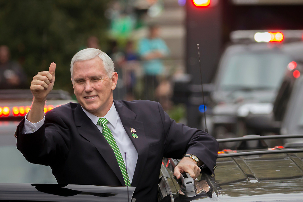 Vice President Mike Pence give a crowd a thumbs-up right before climbing into his motorcade at the Savannah St. Patrick's Day parade, Saturday, March 17, 2018, in Savannah, Ga. (AP Photo/Stephen B. Morton)