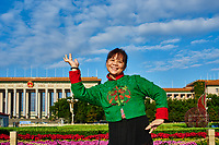 Beijing , China - September 24, 2014: Chinese woman in tradiotional costume dancing in Tiananmen Square Beijing China