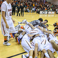 022515  Adron Gardner/Independent<br /> <br /> The Gallup Bengals celebrate as District 1-5A champions after beating the Farmington Scorpions 65-48 at Gallup High School Monday.